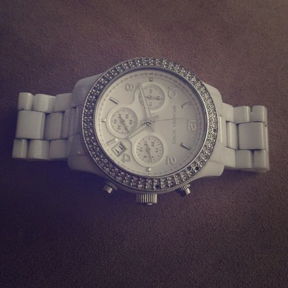 Michael Kors white ceramic watch swarski face MK - white ceramic , swarski face watch , perfect for spring and summer . Missing a few stones easily replaced when you bring it to MK . Otherwise white is brand new no discoloration ...  Michael Kors Accessories Watches