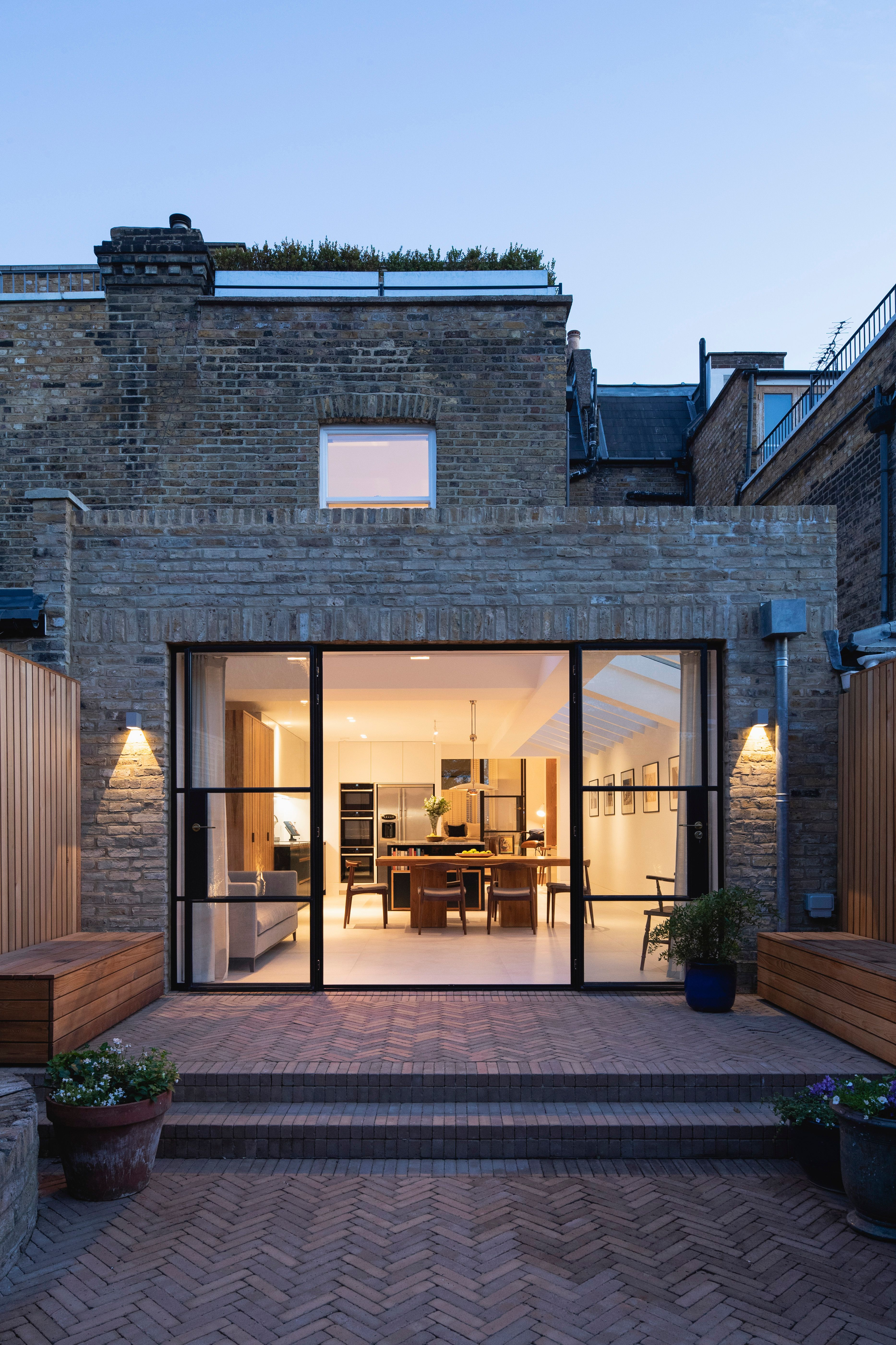 Rear extension with herringbone brick patio paving  Oliver Leech Architects St M…
