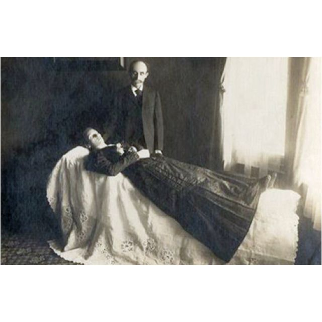 """Death, in Victorian England, was a grand and complicated business. There were many social rules in the classes who could afford it about mourning clothes, degrees of morning, and the length of time for which different mourning colours were to be worn.  A widow, for example, wore """"deep mourning"""" (non-reflective black) for a year, including a full veil if she went outside. She then wore any colour black for another 9 months, then light mourning (including grey and purple) for another 3 to 6…"""