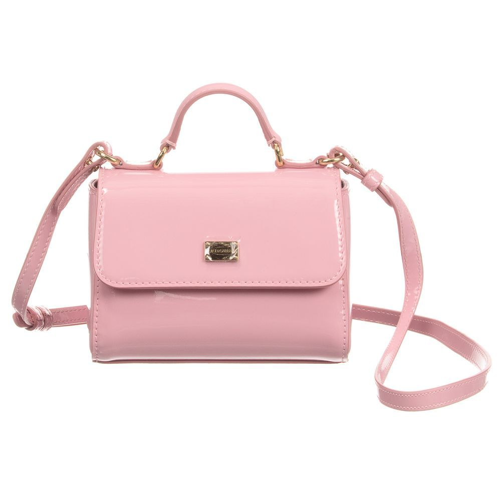 34e5a32a7522 Girls pink patent leather bag from Dolce   Gabbana. This luxury design has  a carry handle