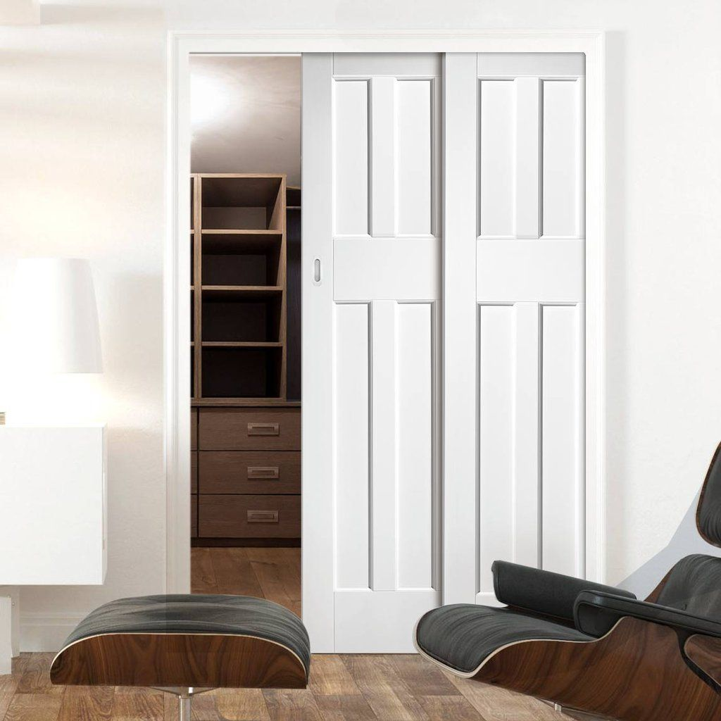 Twin Telescopic Pocket DX60's Style White Primed Panel Doors.    #pocketdoors #telescopicdoors #hiddendoor #doors #doubledoors #moderndoors #doors #interiordesign