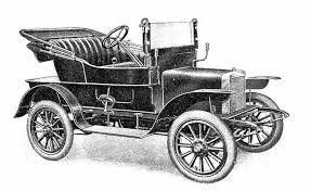 Een van de eerste auto's. In de koplampen zitten kaarsen. De elektromotor drijft de auto aan om vooruit te komen. Met kaarsen kon je 's avonds niet veel zien. De gloeilamp werd uitgevonden. Dat geeft veel meer licht dan kaarsen.