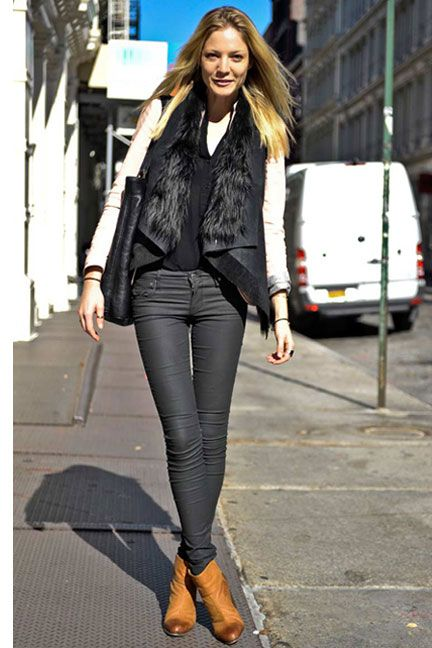 Warm up with a black shearling vest #streetstyle