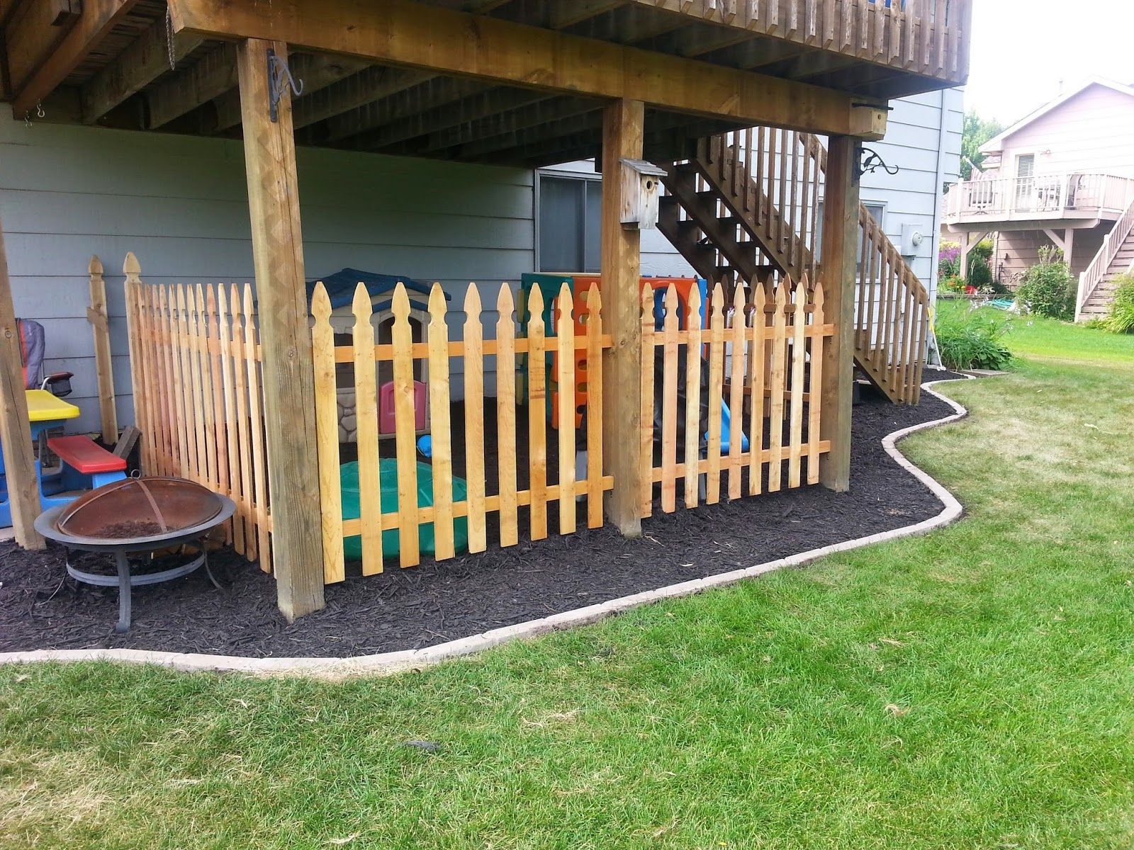 Under Deck Landscaping and Fenced Kids Play Area