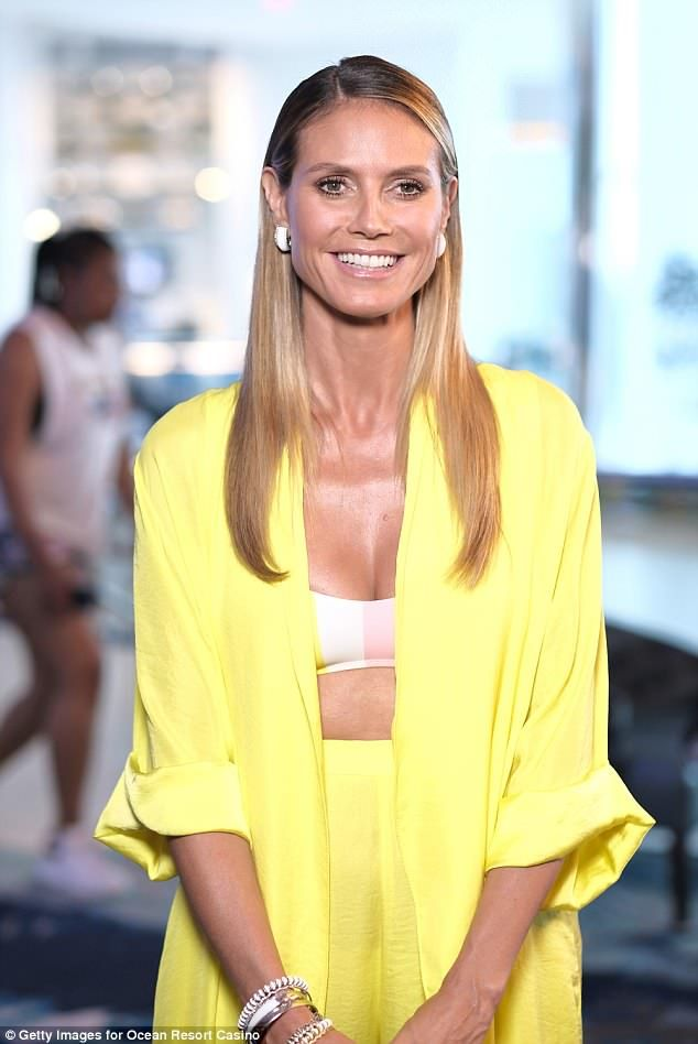Heidi Klum wears plunging white dress for night out in