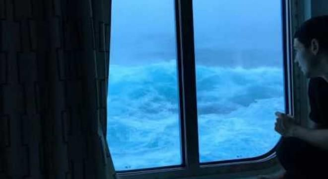 Surprisingly Chill Passengers Watch Huge Waves Batter Their Third-Floor Cruise Ship Window