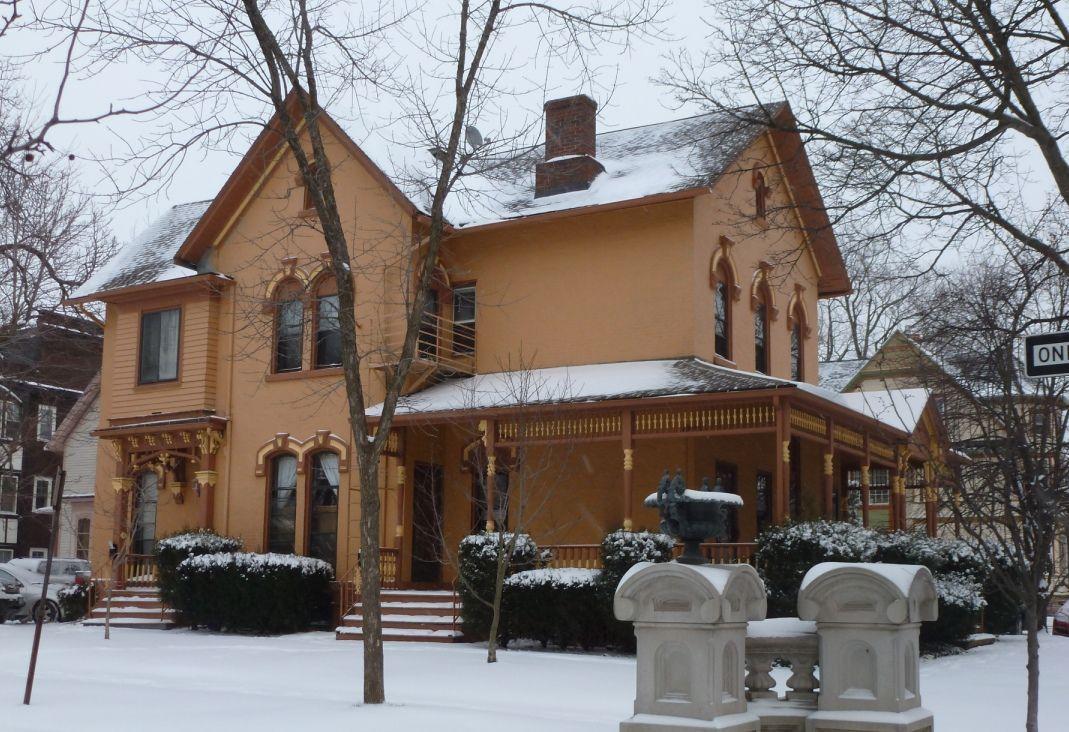 An orange italianate style house on the corner of park