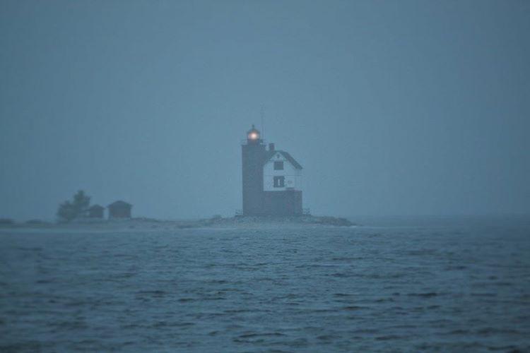 """#Mackinac is surrounded by #fog this evening. ⚓️ #RoundIsland #Lighthouse #MackinacIsland"""