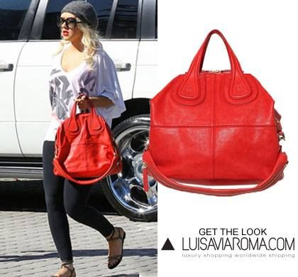 Christina Aguilera adds a pop of color to her (nearly) monochrome ensemble with the Givenchy Nightengale in cherry red. What's your favorite shade?