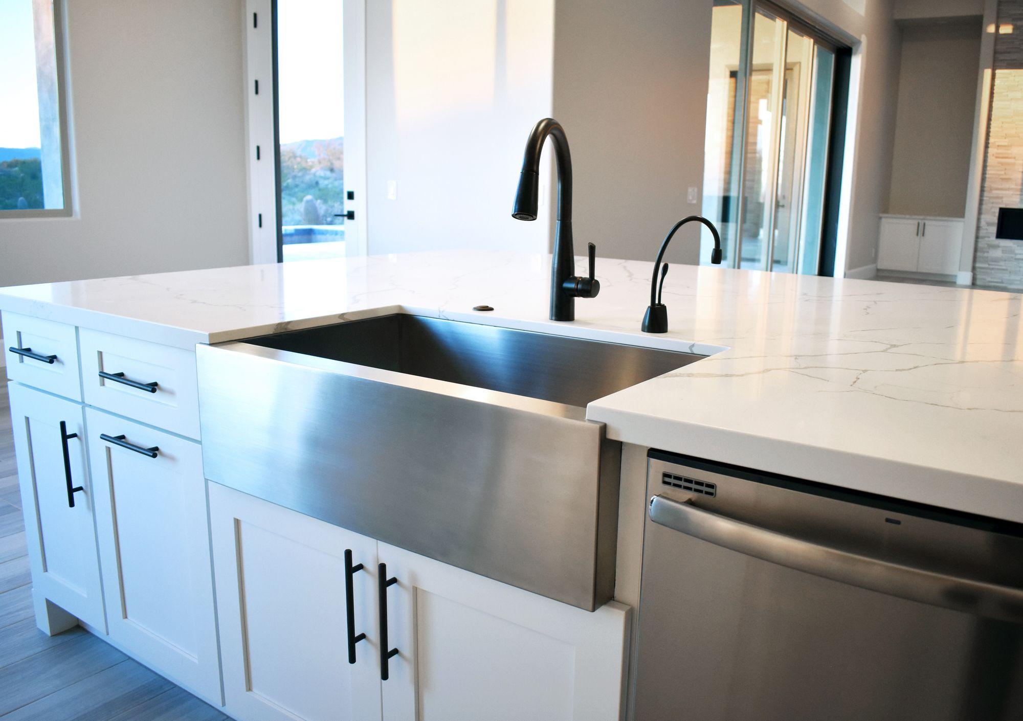 All White Kitchen With Stainless Steel Farmhouse Sink In 2020 Stainless Steel Farmhouse Sink Kitchen Cabinets And Countertops White Modern Kitchen