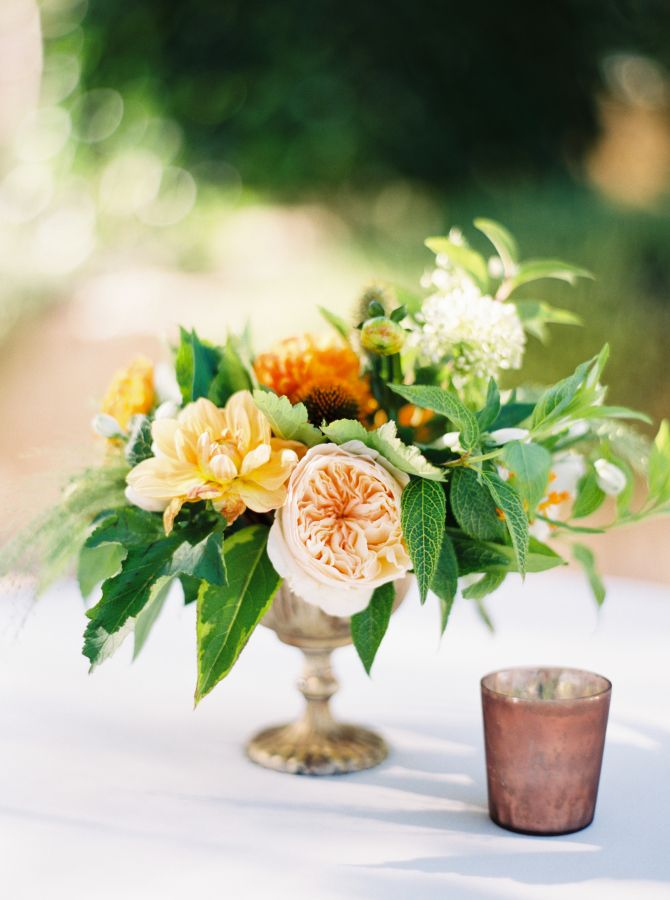 Peach and yellow rehearsal dinner centerpiece: http://www.stylemepretty.com/2017/03/23/from-rehearsal-dinner-to-big-day-this-celebration-is-one-for-the-books/ Photography: Erich McVey - http://www.erichmcvey.com/