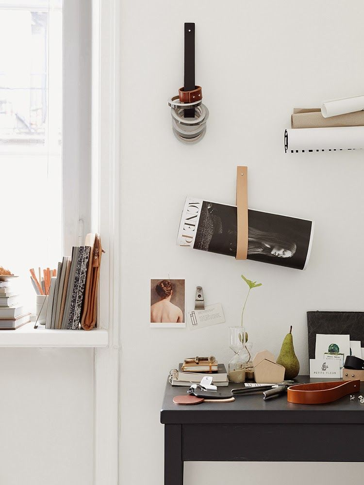 a variety of ways to use a leather strap; for your favorite bag, magazine, jacket or book. place it in your home or workspace. perfect for your hallway or next to your couch or bed.