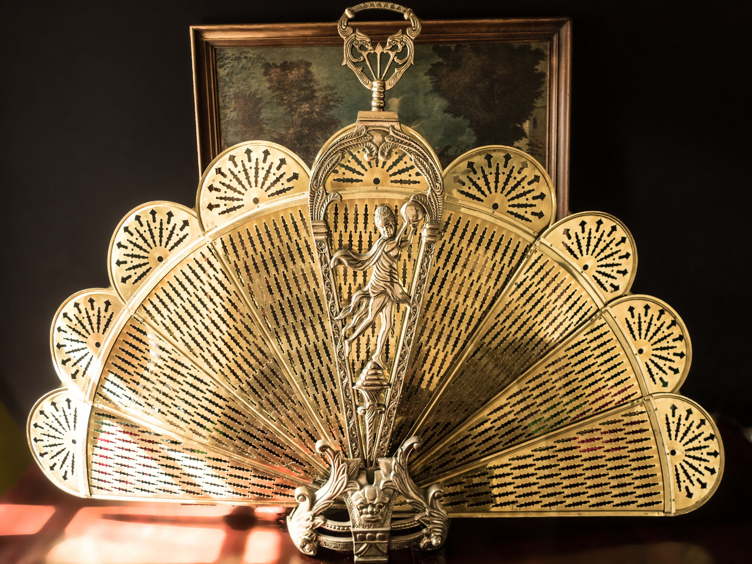 brass fireplace fan