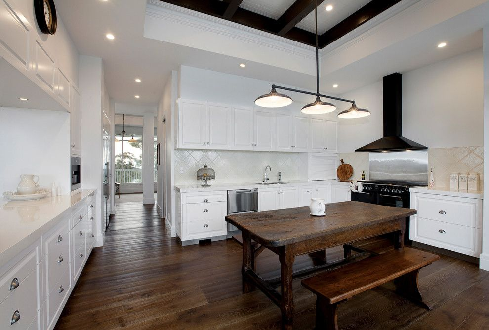 Dark wood farm table kitchen farmhouse with white kitchen cabinets ...