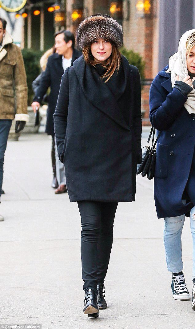 Not feeling the heat! Dakota Johnson wraps up for a cold walk in NYC... as Fifty Shades Of Grey continues to fire up at the box office
