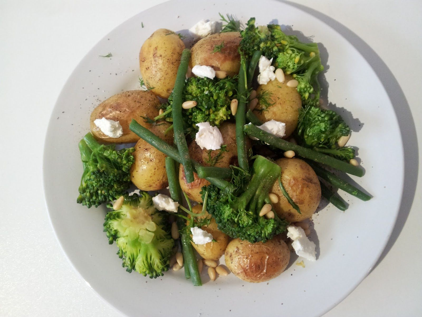 Lemony Potato, Broccoli, and Goat Cheese Salad- substitute asparagus for the green beans, and we're good to go.