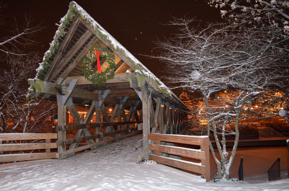 downtown naperville christmas cross over the moser covered bridge that leads to the riverwalk and downtown naperville