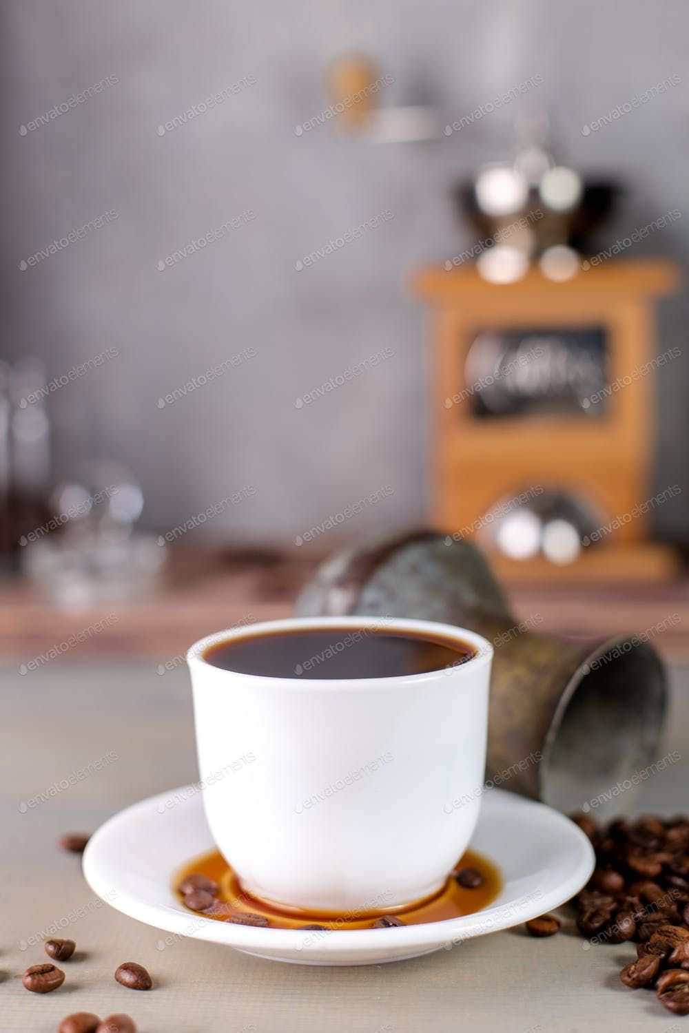 A White Cup Of Hot Coffee In A Scattering Of Coffee Beans On A