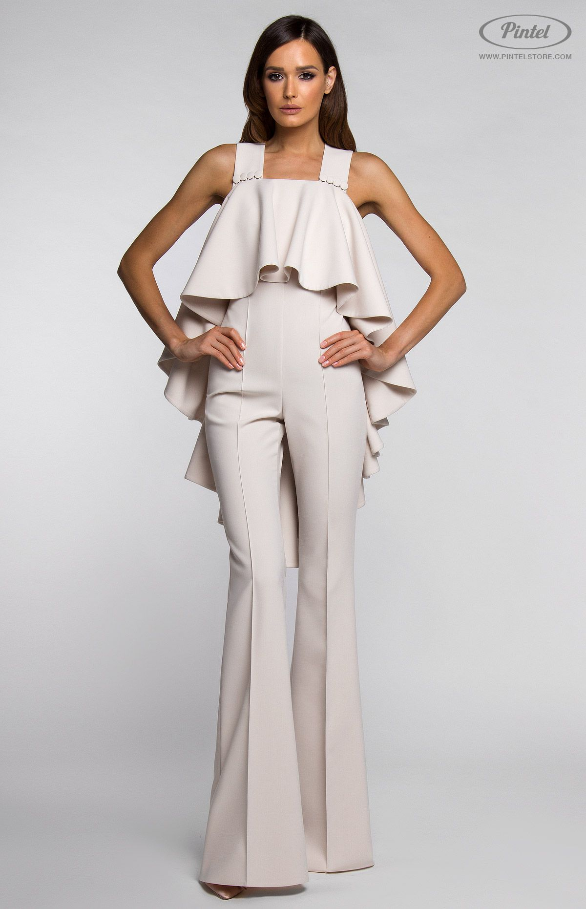 cf7c048e4041 Slim-fit sleeveless jumpsuit with wide bottom flounce. Open back with  crossed straps and button closure in front. Hidden side zip closure.  Without pockets.