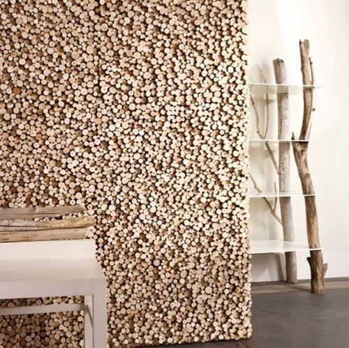 a unique wall covering made of rough-cut wood pieces in differing