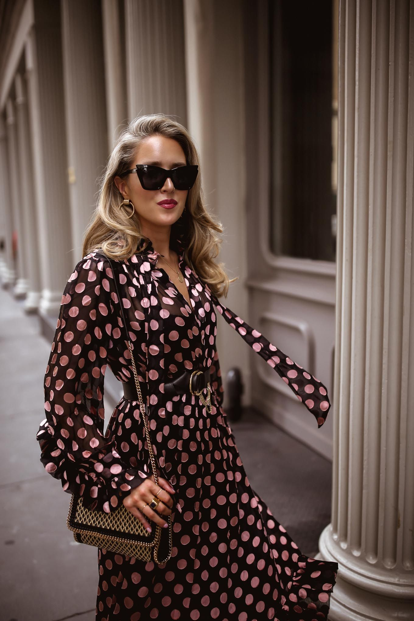 5ccb072dffb Mary Orton fashion blogger in Zimmerman pink black polka dot dress  accessorized with sunglasses