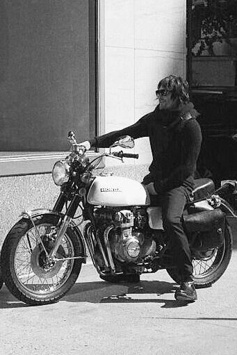 Reedus in all black on his bike. .