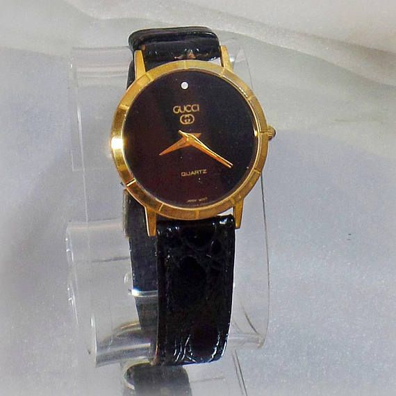 8b534299e0f This  vintage black diamond Gucci watch is absolutely gorgeous! This ladies  watch features a round gold case with a black face and gold hands and  hashmarks.