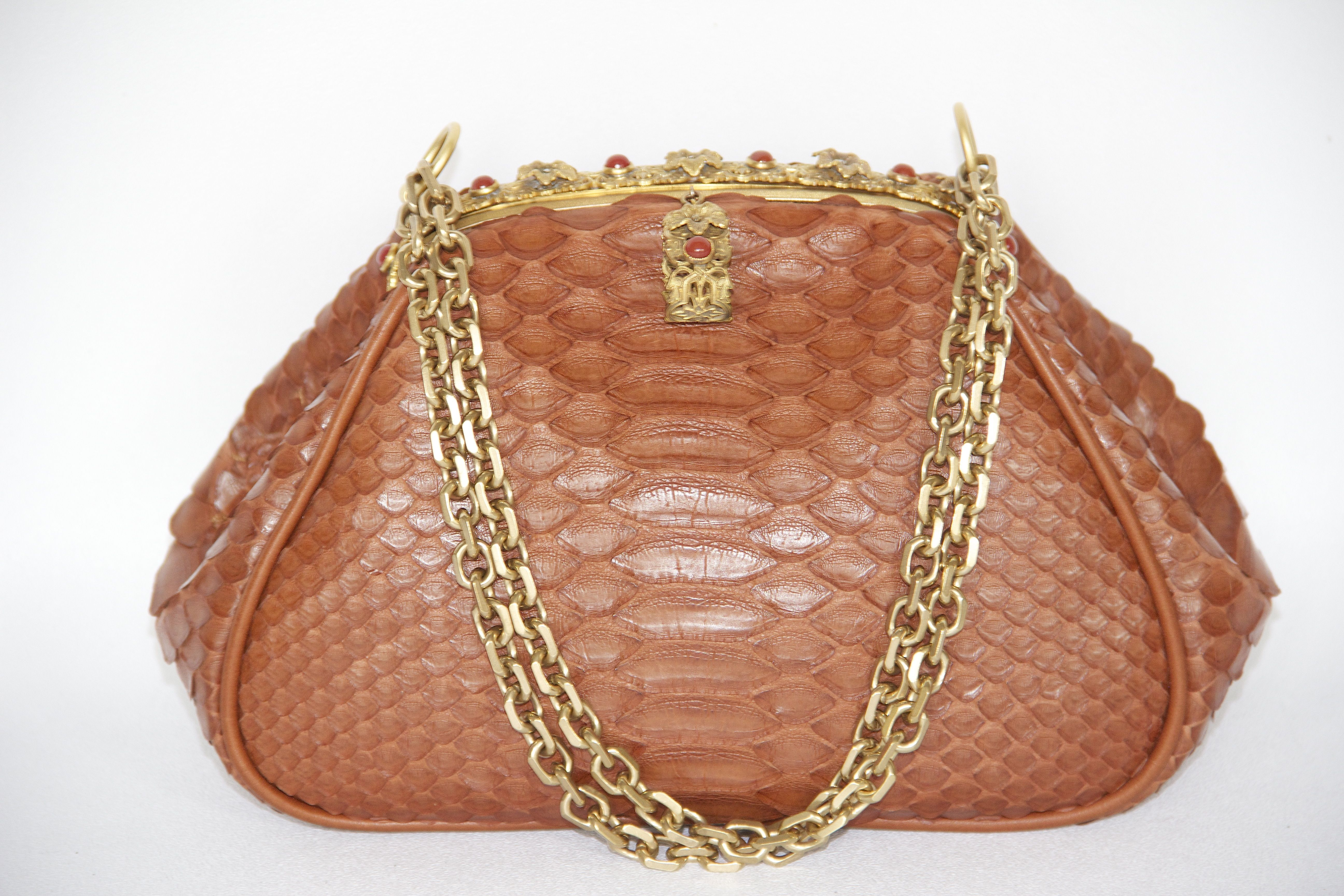 Cognac python with gold chains and studded frame