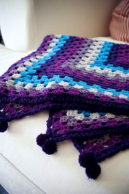 Love the colors and the pattern on this crocheted blanket.