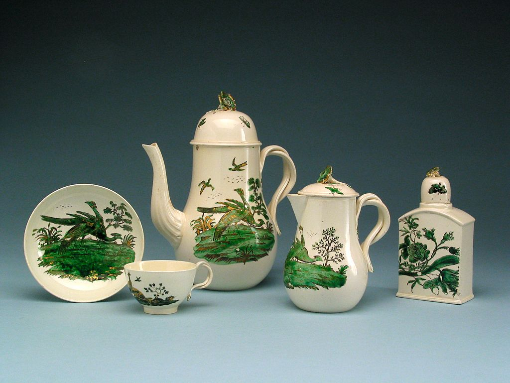 Coffee pot and teawares, Staffordshire, England, c. 1775. Creamware with black and green enamels and gilding.