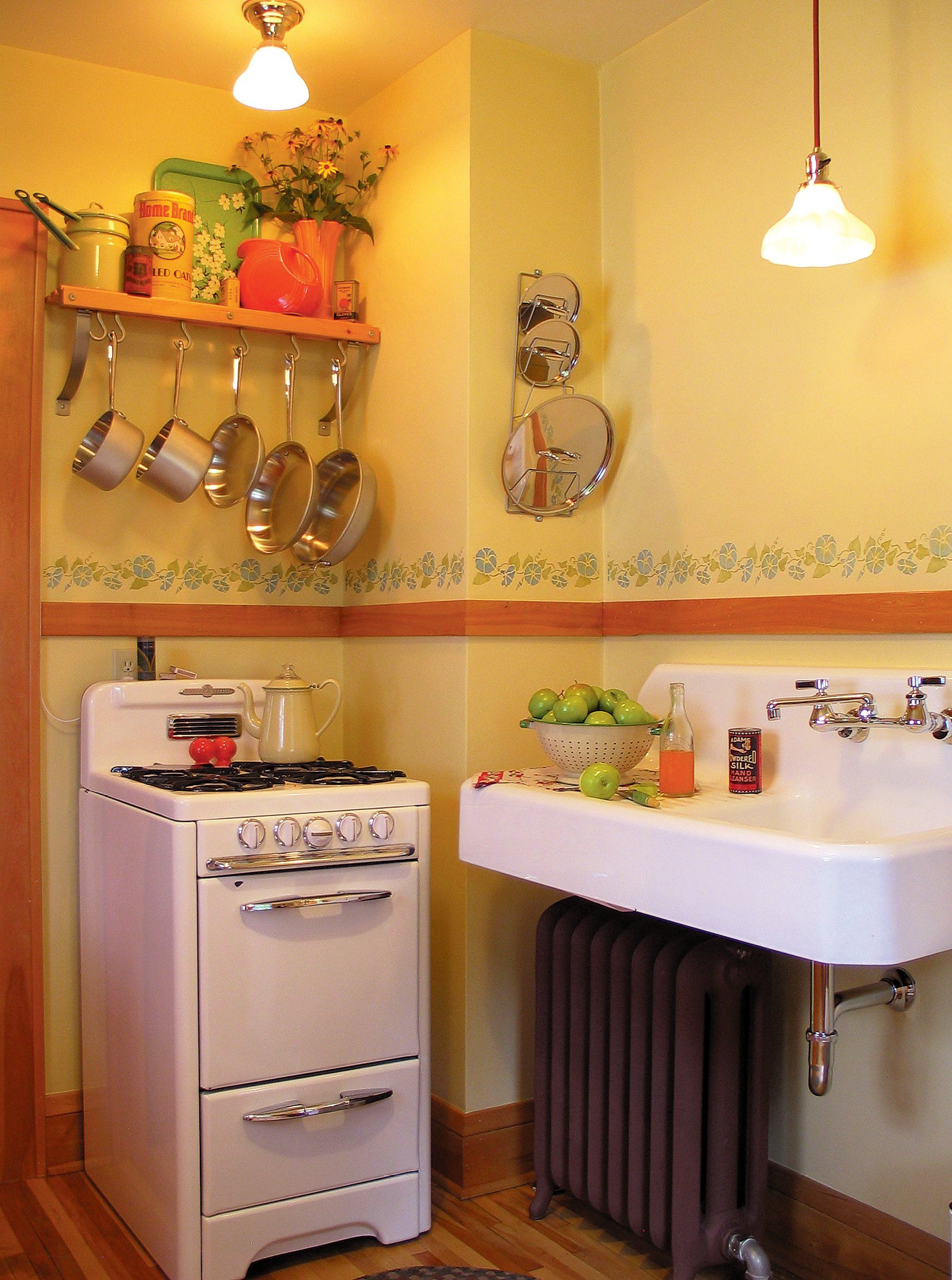 that s one small kitchen like the hanging pots and pans rh pinterest com