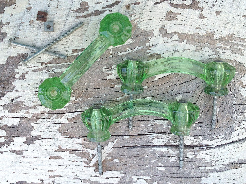 "Set of 3 (Three) Vintage Green Glass Pulls / 3"" Centers, 4"" Long / Coke Bottle Green Glass Handles. $24.95, via Etsy."