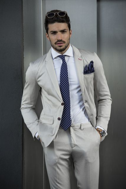 Khaki suit + matching navy polka dot tie and pocket square 9fba92fc547