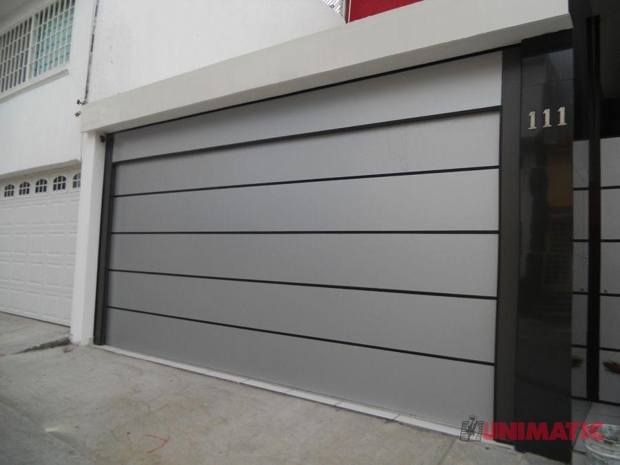 Dise o de puerta en alucobond color champagne proyectos for Puertas para garage