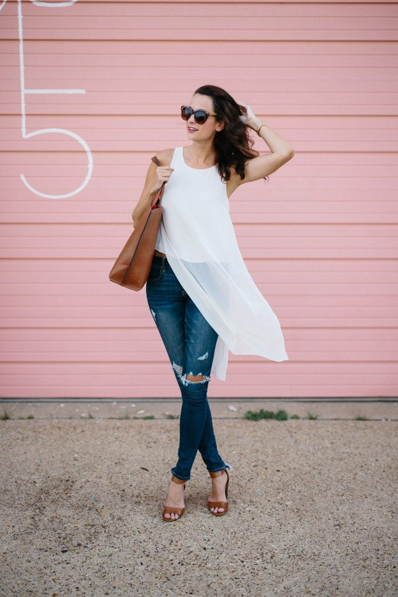The Miller Affect wearing a white sleeveless chiffon top