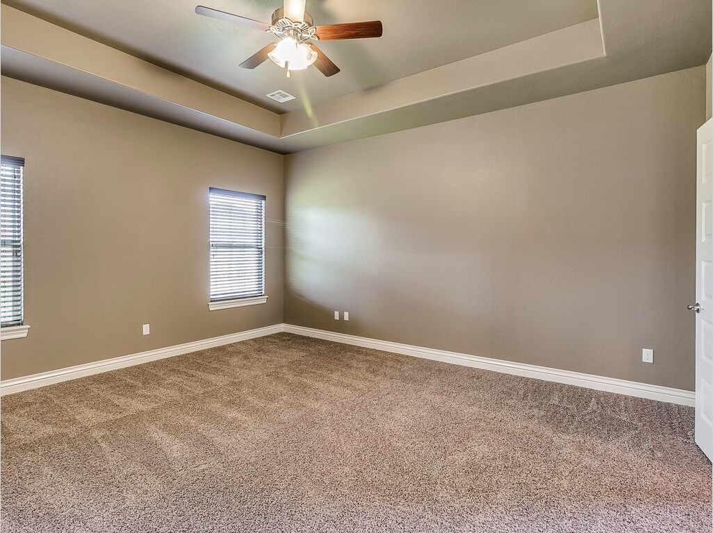 Master Bedroom Designed With Earth Tones Tan Carpeting