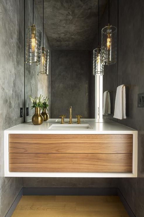 Chic modern powder room is lit by rippled glass light ...