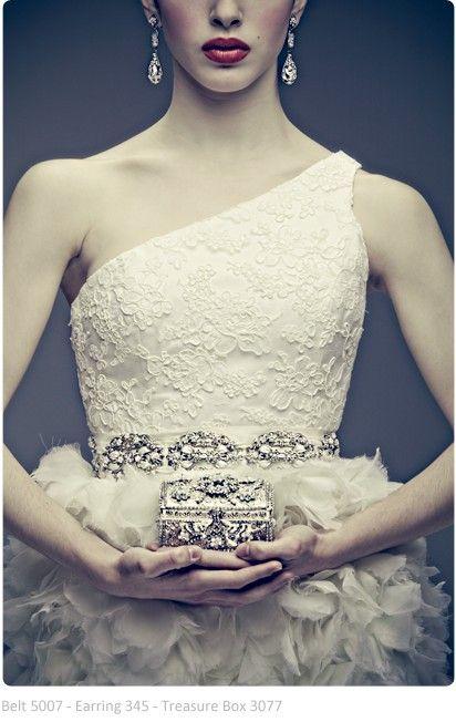 Maria Elena earrings, belt, and purse.