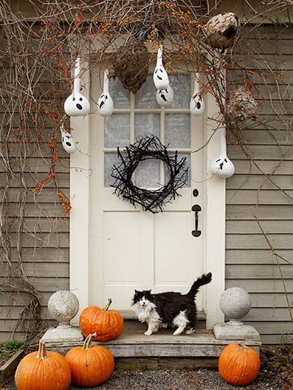 see some of our favorite halloween door decoration ideas including creepy front door wreaths spooky porches and festive accessories - Front Door Halloween Decorations