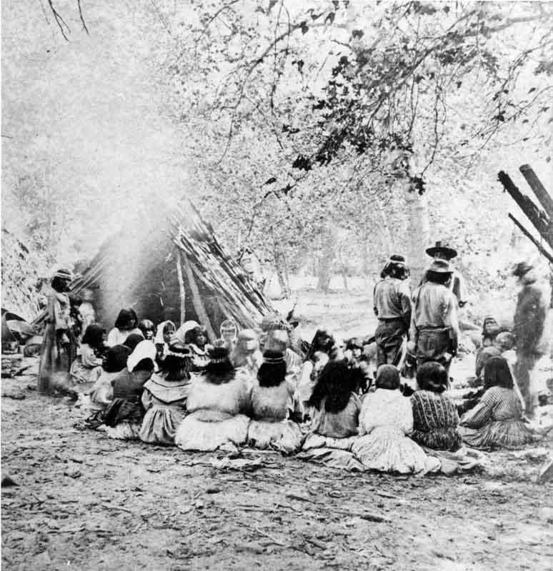 Group of about twentysix native americans seated and