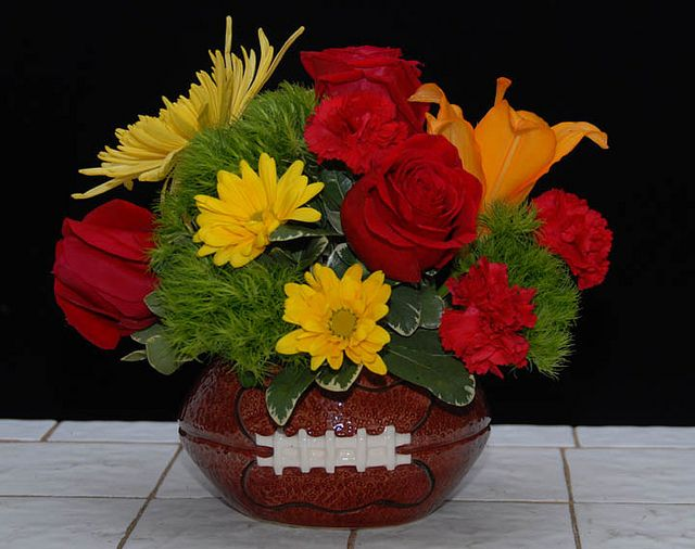A Variety Of Flower Arrangements Created In Football Container For The Sports Enthusiast