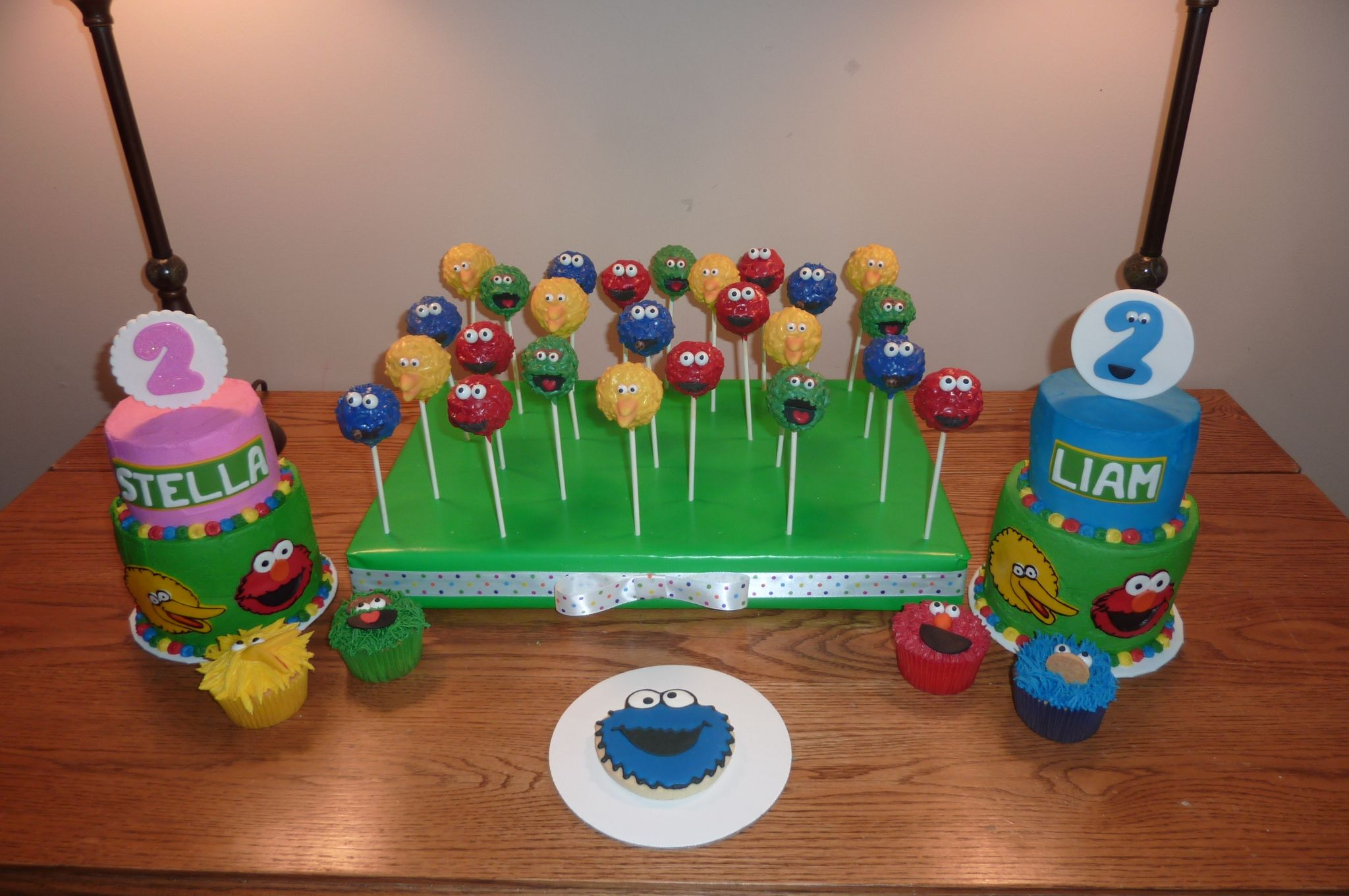 Sesame Street Birthday Sweets for a twin birthday.  Smash Cakes, cupcakes, cake pops and cookies.