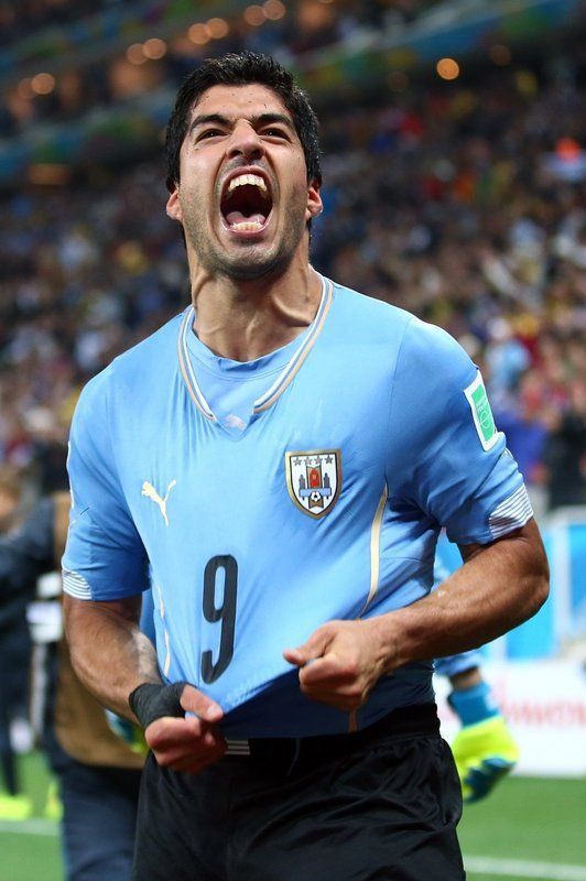 FIFA World Cup 2014 - Uruguay 2 Inglaterra 1 (6.19.2014) - El Nuevo Herald uis Suarez of Uruguay celebrates after scoring his team's second goal during the 2014 FIFA World Cup Brazil Group D match between Uruguay and England at Arena de Sao Paulo on June 19, 2014 in Sao Paulo, Brazil. Julian Finney / Getty Images