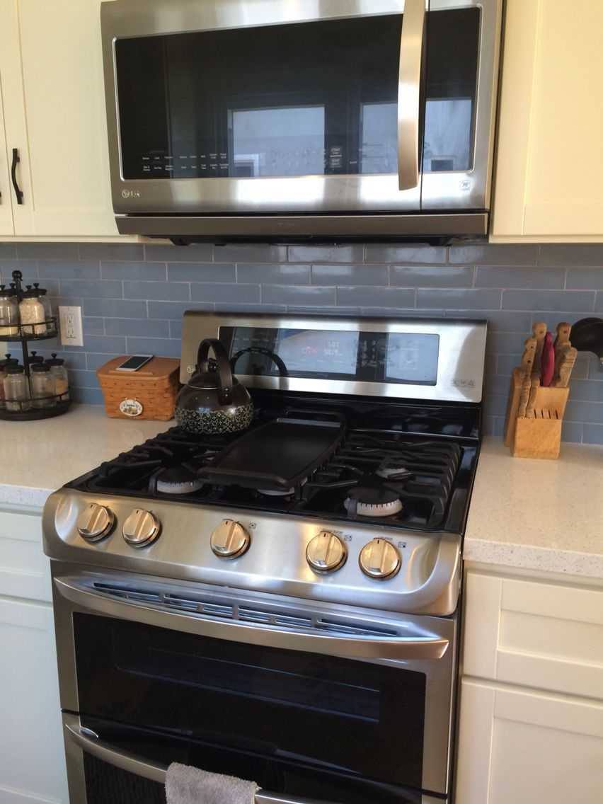 Lg Double Oven Range With Lg Over The Range Microwave With A Fan