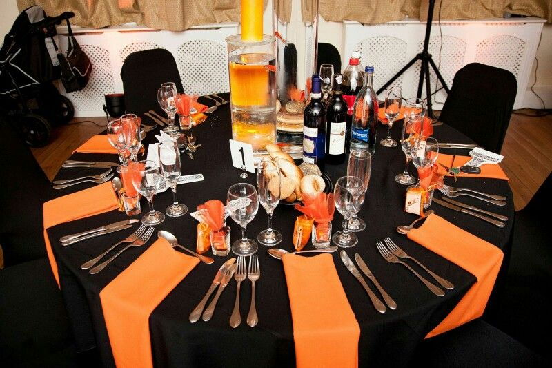 Orange theme, with goldfish under the candles are a centre piece