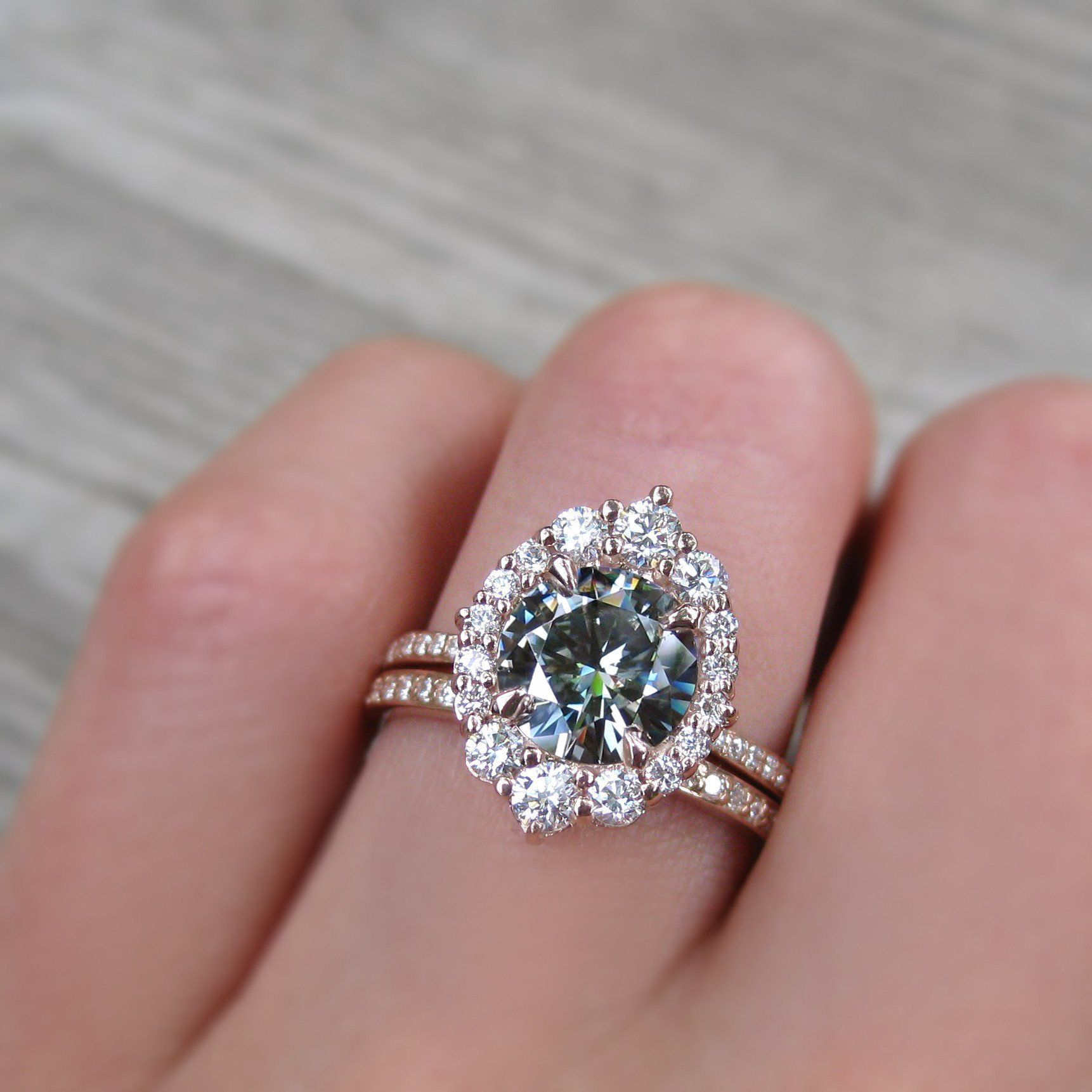 2 carat grey moissanite halo engagement ring paired with a conflict ...