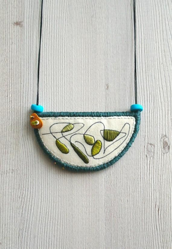 Photo of Bib necklace statement, crescent pendant, modern embroidery necklace, embroidered pendant, fabric necklace, textile jewelry, short necklace