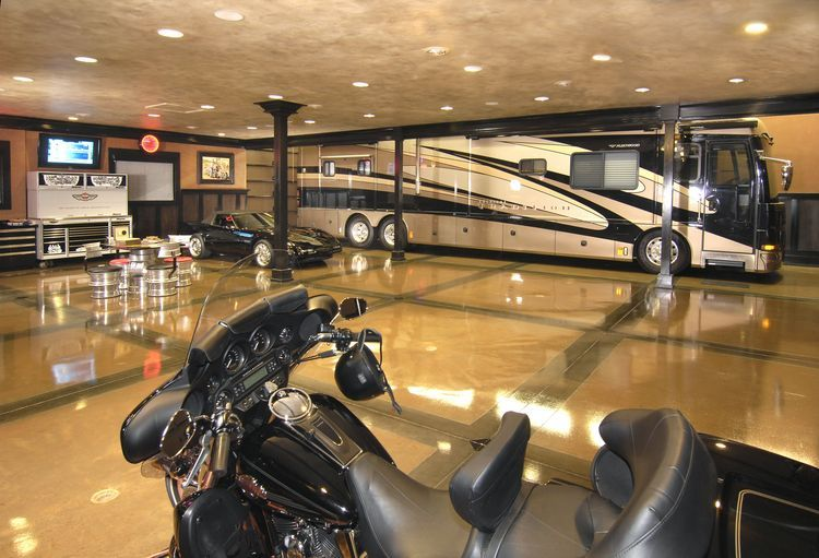 6 plus cars in this showroom garage with for Custom garage workshop