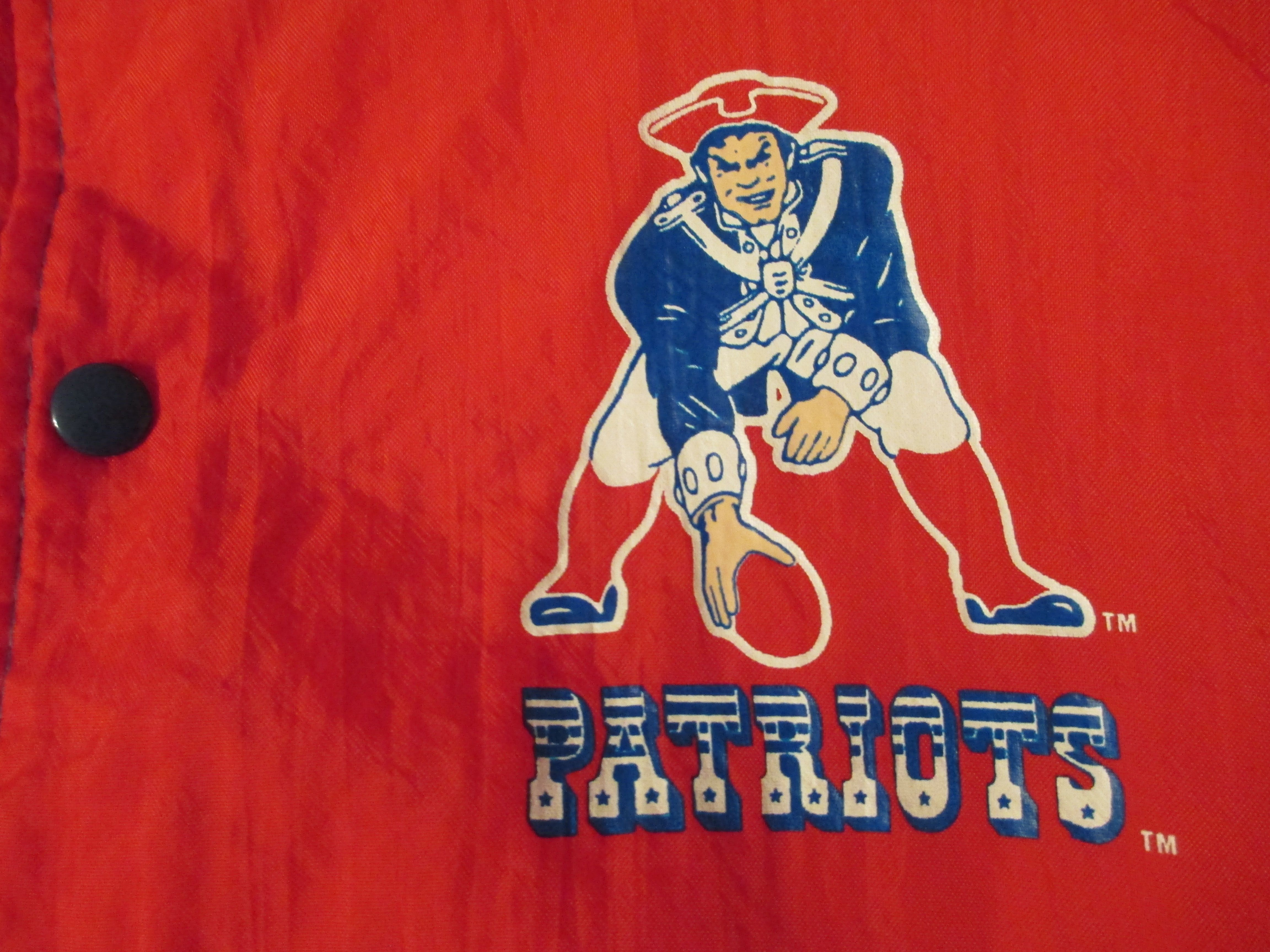 vintage New England Patriots pat the patriot old logo and wordmark on nylon windbreaker jacket vintage 80's early 90's NFL type font typography typographic word mark