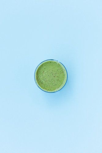 green smothie on blue background
